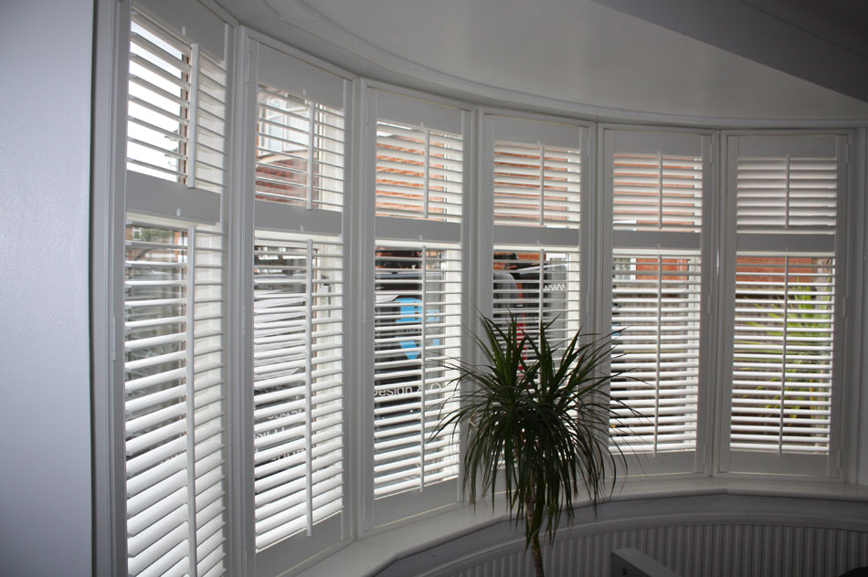 Wood Shutters fitted on a Bay Window with Mid Rail